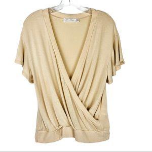 All in Favor cream cross flutter sleeve sweater